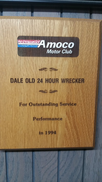 Picture of Award given to Dale Old 24 Hour Wrecker for Outstanding Service Performance by Amoco Motor Club