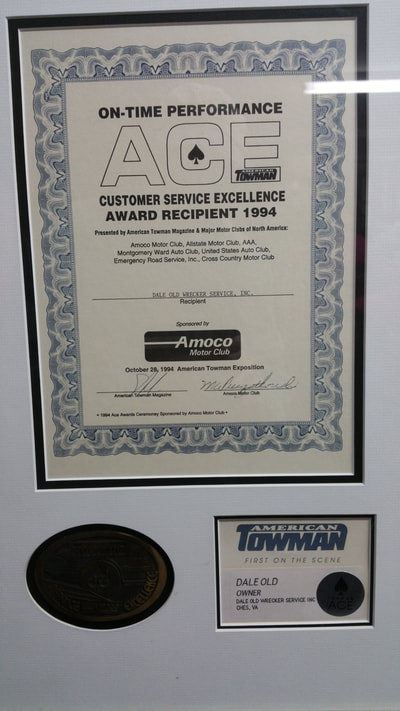 Picture of the American Towman Award presented to Dale Old Wrecker Service for Excellence in Customer Service