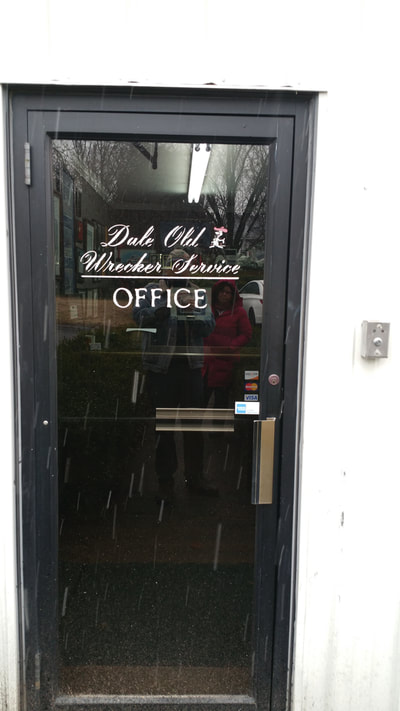 picture of the front door to dale old wrecker service offices