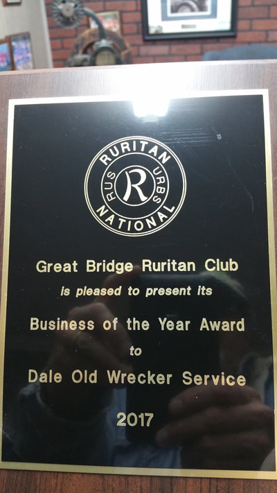 picture of the award given to Dale Old Wrecker Service by great bridge ruritan club as the 2017 business of the year award