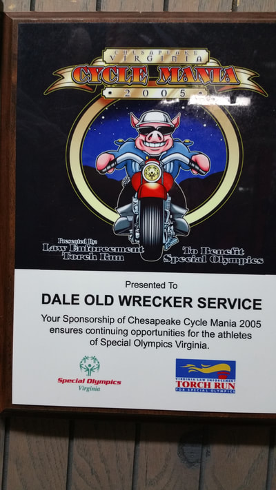 picture of award given to dale old container moving for sponsorship of cycle mania