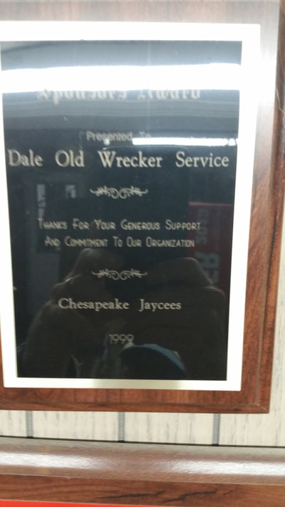picture of sponsor award presented to dale old heavy hauling