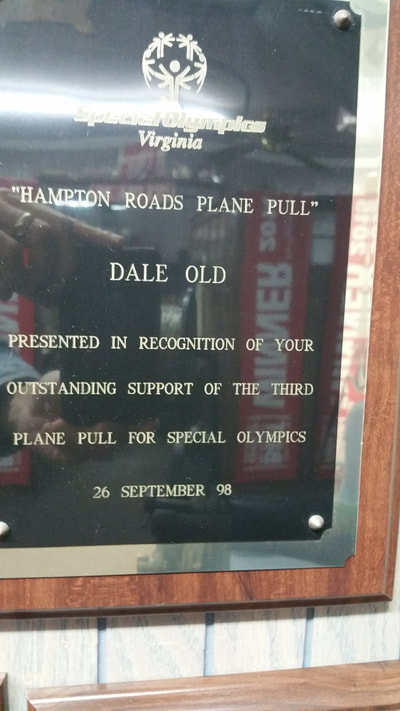 picture of the special olympic award given to dale old container hauling for outstanding support